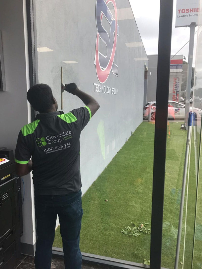 Window Cleaning Service With Commercial Blade